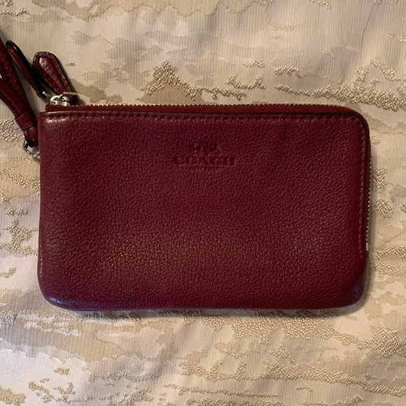 Coach Wristlet in a maroon color with 2 zippers